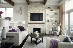 This neutral living room with pops of purple makes smart use of space with TV mounted above fireplace and tall bookshelf to the side. |  Andrea's Innovative Interiors - Andrea's Blog - Design Details