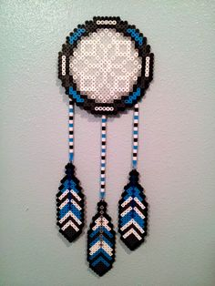 Perler bead dreamcatcher up on my wall :) It uses white and clear beads for the inside design