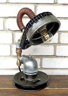 Industrial Table Lamp, Edison bulb table lamp, Vintage style lighting, Modern industrial lighting, Cheap industrial lighting, Pipe Lighting Table lamp Bumblebee vendor code 01-67 Height: 35 cm (1ft 1.78in). Weight: 5.5 kg (12lb 2.01oz). Frame diameter: 16 cm (6.30in). Standards for bulb: E12, E14, E17, E26, E27. Wire length: 70 cm (2ft 3.56in). Switch is put on the wire, at the customers order at any distance from the lamp. A light bulb is not included in the kit. The product is ready for…