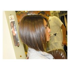 I wish my haircut was more like this.  Her hair is way too short like mine but its got some angle.  Mine is too square looking