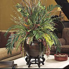 "Faux Flower Arrangements & Decor http://www.officescapesdirect.com Brighten any area with Silk Cycas & Croton Mixed Planter Item Number: PLA270-NA Price $269.00 42""H x 36""W Lush & Lifelike Silk Foliage Dramatic Realism"