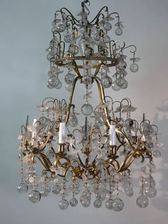 Large French regence style #chandelier, gilt metal birdcage type with crystal pear drops and amber glass flower bagues. **Available to hire** (Stock code;- LIGC10068)    www.farley.co.uk Chandelier Lighting, Chandeliers, Pear Drops, Clever Design, Amber Glass, Bird Cage, Antique Furniture, Light Up, Ceiling Lights