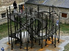 'Revolution' - public art by Michel de Broin at Couvent des Jacobins, Rennes, France; the 131 feet long staircase forms a knot, allowing one to 'enter an infinite cycle of revolutions'; 26 x 16 x 21 feet Animal Shelter Adoption, Institute Of Contemporary Art, Jungle Gym, Roadside Attractions, Public Art, Public Spaces, Staircase Design, Michel, Community Art
