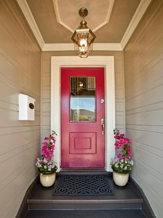 Front Door Decorating. The cheery pink theme is carried to pots flanking the doorway filled with bouganinvillea and candytuft. The terracotta tile steps and board-and-batten siding also receive a makeover with fresh coats of warm, neutral paint.