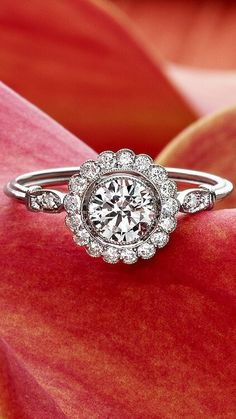 A stunning example of Retro-era style, this glamorous engagement ring features three dazzling round brilliant cut diamonds at the center surrounded by a loop of white gold and twelve glittering diamond accents (approx. Available in White Gold. Ring Set, Ring Verlobung, Hand Ring, Jewelry Box, Jewelry Accessories, Fine Jewelry, Jewlery, Wedding Engagement, Wedding Rings