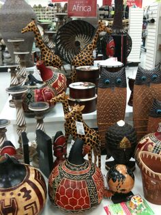 cool african decor that I know Wilson will love. he WAS a history major (somewhat) specializing in african history after all =) African Living Rooms, African Room, African House, African Theme, African Art, African History, African Jungle, African Culture, African Crafts