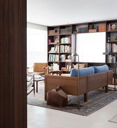 Felipe Hess // Apartment On Oscar Freire Str. in São Paulo // library around windows in modernist apartment