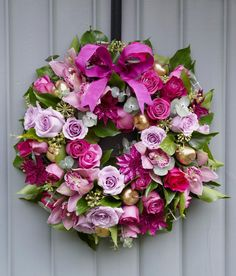 Make a colourful Christmas wreath full of flowers for your front door