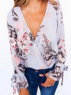 Fashion and sexy, this blouse is perfect for you. With V-neck and long sleeves, this blouse features cross front design that gives it a lady style, edgy look. Wear it with jeans would be great!
