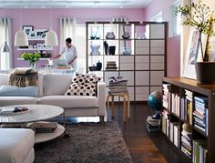 Using bookcase to define and divide living spaces