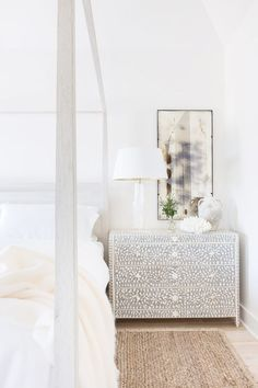 """From the natural woven sisal rug, to the Belgian linens on the bedding and heavy weaved linen draperies. For the nightstands an antiqued mirror hangs above a gorgeous bone inlay chest."""