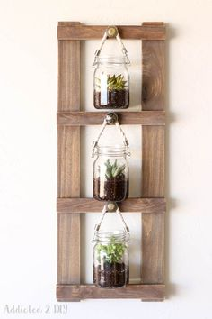 Such a great idea for hanging plants, photos, or even craft supplies! The step by step tutorial is easy to follow and only takes a few supplies!