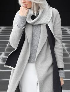 Grey On Grey: Joyce Croonen is wearing a pale grey coat from Cos, matching sweater gfrom Acne, white trousers from H&M and the grey scarf from Balenciaga