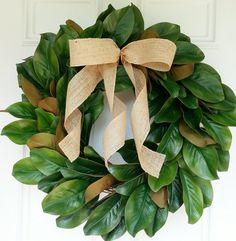 This wreath is made from a grapevine base and is covered with an abundance of…