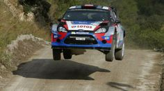 Lotos World Rally Team driver Robert Kubica getting airtime in his Ford Fiesta WRC car. Ford Motorsport, Rally Car, Vehicles, Cars, Sports, Racing, Hs Sports, Rolling Stock, Autos