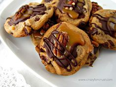 Chocolate Chip Turtle Cookies   Ingredients: 3 squares semi-sweet chocolate, divided 1 tablespoon butter 12 chocolate chip cookies, baked and cooled (from your favorite recipe, a tube, or even a package of Chips Ahoy!) 6 caramels 2 teaspoons milk 12 pecan halves