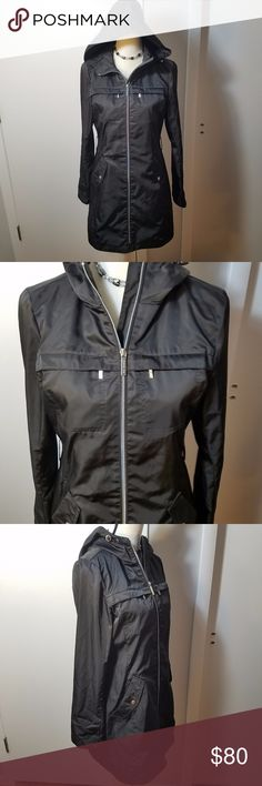 MICHAEL Michael Kors Black Zippered Windbreaker Excellent pre-owned condition. No damages, stains, or wear. Features 4 pockets in the front and sides, hooded, and has a liner layer. Possibly water resistant, but not an actual raincoat. Great for cool weather days, but not snow. Measurements are in the picture. Has belt loops but no belt included. MICHAEL Michael Kors Jackets & Coats Utility Jackets