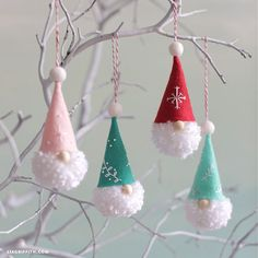 pom-pom gnome ornaments hanging on white banchesHow to Make Pom-Pom Gnome Ornaments - Lia Griffith, the tomte of Sweden and the nisse of Norway. Scroll down for how to make these simple Christmas crafts, or browse our other pom pom craft Christmas Pom Pom Crafts, Noel Christmas, Christmas Crafts For Kids, Diy Christmas Ornaments, Christmas Projects, Handmade Christmas, Holiday Crafts, Christmas Decorations, Christmas Ideas