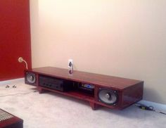 Color me impressed, not only did doitdoitdoit design and make his own coffee table, he built a matching TV stand with integrated audio speakers using some car speakers he had laying around