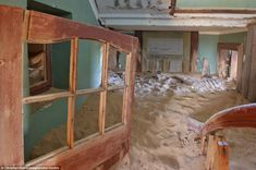abandoned house in kolmanskop | Sands of time: The interior of a house filled with sand in Kolmanskop ...