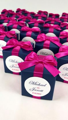Navy blue wedding favor box with fuchsia satin ribbon bow and custom names, Elegant bonbonniere. Personalized gift boxes make a unique way to thank guests for attending your special day. #welcomebox #giftbox #personalizedgifts #weddingfavor #weddingbox #weddingfavorideas #bonbonniere #weddingparty #sweetlove #favorboxes #candybox #elegantwedding #partyfavor #navybluewedding #bluewedding #giftboxes #uniqueweddingfavors #uniqueweddingideas #fuchsiawedding Wedding Favours Navy Blue, Handmade Wedding Favours, Personalized Wedding Favors, Blue Wedding, Wedding Gifts, Wedding Candy Table, Candy Wedding Favors, Wedding Favor Boxes, Destination Wedding Welcome Bag