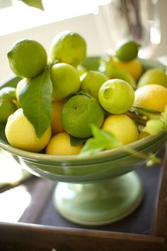 Lemons and limes make a fine centerpiece in a footed bowl