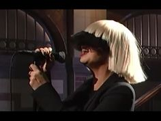 "This is the live mic feed. An amazing vocal performance by Sia of her song, ""Chandelier"". We've zoomed in, with this video - a focus on Sia's singing. (Apolo..."