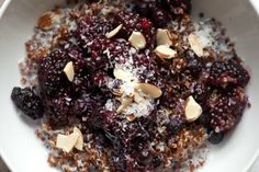 Reheated quinoa, with a splash of milk, topped with blackberries, blueberries, coconut, almond, and a splash of balsamic vinegar