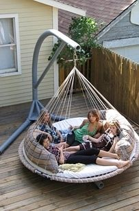 The hanging swing trampoline everyone can just pile into. | 30 Impossibly Cozy Places You Could Die Happy In
