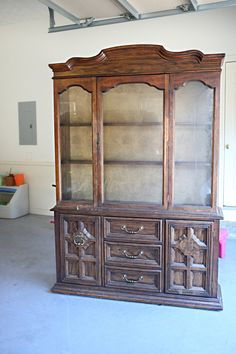It's pretty amazing what this gal did with this gross, old china cabinet she got from Goodwill. This is upcycling at it's best! :)