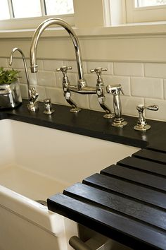 https://flic.kr/p/5VmpqN   Sink detail   Soapstone countertop has been grooved to make drainage of dishes easy.