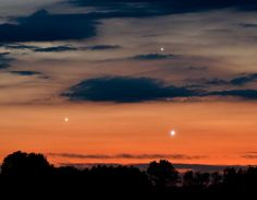 Last night, Venus, Jupiter and Mercury converged to form a bright triangle in the sunset sky.