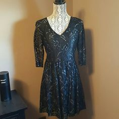 """Kensie Black/Silver Lace Cocktail Dress - Size M NWOT - Black lace cocktail dress w/Silver metallic accents. V-neck, back zipper, 3/4 sleeves. Rayon/Nylon. Fully lined. 32"""" total length. Arms fit tight on me. Kensie Dresses"""