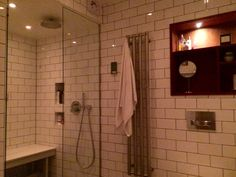 Bathroom steambath shower White tile mahogany shelf