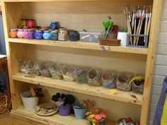 """Art room organization: """"paints in their own little bottles for the children to choose from, collage materials and glue, drawing implements and stamps."""""""