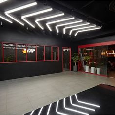 illuminated arrows Gym Design, Garage Design, Car Detail Shop, Dance Studio Design, Shoe Store Design, Ultimate Garage, Garage Lighting, Linear Lighting, Showroom Design