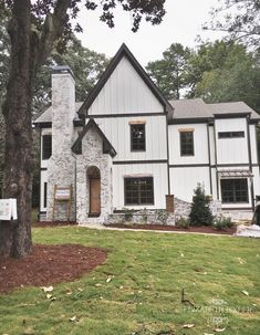 lime wash brick exterior, white house , board and batten