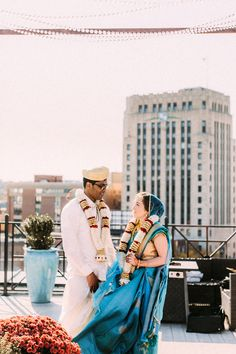 With a rooftop view, modern decor, and a blend of Christian and Hindu wedding traditions, this blended wedding is one of the most stunning we've ever seen! | Image by Rhino Weddings