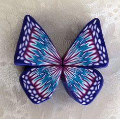 http://malsarts.blogspot.com/2009/08/butterfly-wing-cane-tutorial.html