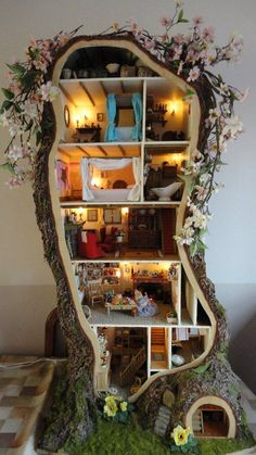 A multi floor faerie house with multiple rooms to see inside and furnished with tiny furnishings.