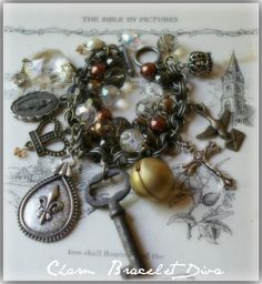 Vintage Fleur de lis, medal, key and locket charm bracelet