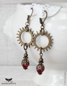 Stunning Steampunk inspired earrings with large bronze cogs. Hanging beneath are Victorian style beaded drops featuing deep garnet red czech glass