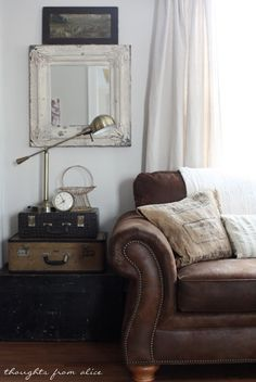 Vintage traveler decoration with leather sofa. Thoughts from Alice: Spring 2014 {Partial} Living Room Reveal