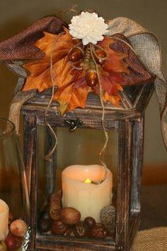 Fall Decor with lantern, acorns, leaves, ribbon
