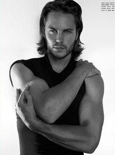 Taylor Kitsch looks really, really good in black and white.