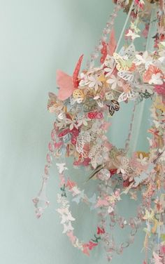 DIY:  Butterfly and crystal garlands mix. Start by covering a wreath ring. Add  garlands and hang by chains. Would be great hanging from a tree for a magical picnic.