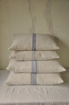 ..focus..damn it! | beyondfrance:   Stack of linen grain sack cushions...