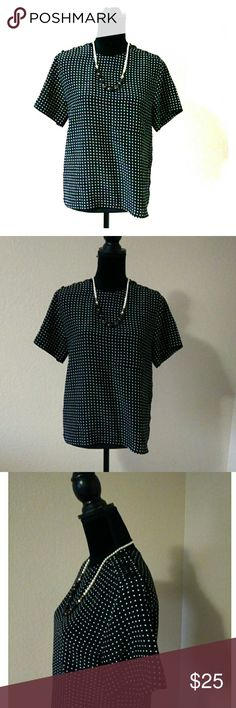 Vintage Polka Dot Blouse Gorgeous vintage blouse! Polka dot pattern, black and white. It is a silk like material. No Size or material tag attached. Beautiful buttons on the shoulders and a chest pocket. I'm guessing a size L or XL. Approx measurements are chest 18, and length 23. Vintage Tops