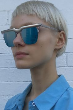 Square frame sunglasses made from acetate and stainless steel.