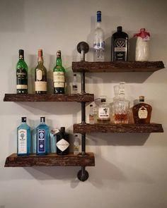 Popular Kitchen Storage Ideas and What They Cost Bar wall shelf with life edge wood and galvanized steel pipe.Bar wall shelf with life edge wood and galvanized steel pipe. Diy Home Bar, Bars For Home, Home Bar Decor, Mini Bar, Bedroom Bar, Galvanized Steel Pipe, Bar Shelves, Glass Shelves, Wall Bar Shelf